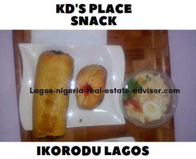 KD's place restaurant sausage, doughnut and salad at Ikorodu Lagos